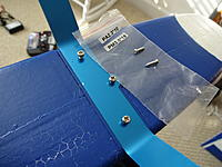 Name: DSC01002.jpg Views: 117 Size: 494.6 KB Description: This package contained the LG mounting screws and the ELE screws to secure them to the fuselage. The paint in the lower left part of the picture shows the paint blemish mentioned in Post 1.