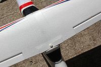 Name: E-Starter08.jpg Views: 120 Size: 197.2 KB Description: Top of the nylon wing bolt. Looks much better not having the black plastic wedge under the screw head like the stock setup.