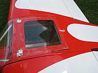 Name: IMG_0343.jpg Views: 225 Size: 457.7 KB Description: Same as battery hatch, rear part of the cockpit access window id secured by surpluss servo arm, bolted on the fuselage.