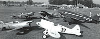 Clockwise starting nearest the camera, Howard Pete, Miles & Atwood Special, Brown B-2, Gee Bee Z and De Havilland Comet. In the row behind are further racers. Travel Air D4D, Travel Air Mystery Ship, T-Craft official race scout and Heath Baby Bullet