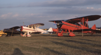 Name: Screen Shot 2021-06-16 at 4.01.38 PM.png Views: 8 Size: 3.93 MB Description: All three of these airplanes were damaged in accidents after this photo (1980s at Oshkosh) On the far left is an HRE which has yet to return to the skies, In the Middle is the ARE that now belongs to EAA and in red is Red Lerille's freshly restored SRE.