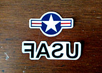 """Name: Flyer-Build Fig. 2 -- 740.jpg Views: 11 Size: 311.8 KB Description: Fig. 2. Two decals cut out. The """"USAF"""" one is a mirror image because the decals are positioned face down."""