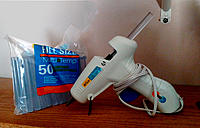Name: Flyer-Build Fig. 6 -- 740.jpg Views: 14 Size: 274.2 KB Description: Fig. 6. Hot-glue gun and glue sticks. A second glue stick is protruding from the gun.