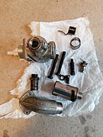 Name: 20190525_115541.jpg Views: 12 Size: 3.39 MB Description: Carburetor disassembled and ready for cleaning.