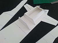 Name: 1457311740517.jpg Views: 35 Size: 92.3 KB Description: From this point I'm trying to figure out  the inside of the ducting. In the plans the side piece forms in the center,  holding the wing mounts. But this is where the edf is going.  This is the 'fun' bit...