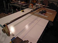 Name: DSCN0060.jpg Views: 85 Size: 375.3 KB Description: Basically my tapered core cutter is a bar on a pivot at one end. The other is a truck on wheels . The bow is clamped to the bar. The bar can rotate up and down to follow the templates on each end of the wing core.