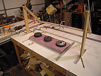 Name: DSCN0041.jpg Views: 91 Size: 632.4 KB Description: The next cutter I came up with works like a swing set. It will cut plank wing cores. The bow swings back and forth as well as pivots up and down to follow the templates.