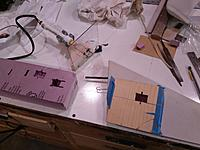 Name: IMAG0383.jpg Views: 9 Size: 938.8 KB Description: The tool is set to the right depth to put the servo just under the surface. The template is taped in place. The scrap piece lets me be sure it is the right temp before cutting.