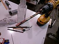 Name: IMAG0385.jpg Views: 9 Size: 851.5 KB Description: Once the pocket is cut I use an aluminum tube to cut a hole to run the servo wire through.
