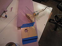 """Name: DSCN0085.JPG Views: 10 Size: 2.43 MB Description: It is a piece of plexiglass with a wooden arm. Mounted to the wood are a couple clips to hold the pipe. It allows the pipe to slide up and down to adjust the depth. The wire it .50"""" piano wire."""