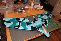 Name: IMG_0106.jpg Views: 130 Size: 579.4 KB Description: The wing span is 43�. The over all length is 24�. It has a 28-36 1400 KV motor and a 45 amp ECS. The battery is a 3 cell 2200 lipo. It will use a 8x4 prop.