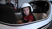 "Name: IMG_20140912_093620_413.jpg Views: 87 Size: 233.6 KB Description: My boy Wyatt sitting in Lancair Legacy ""Jus Pass'n Thru"" race #66"