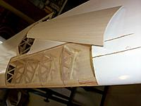 Name: 100_4443.JPG Views: 15 Size: 101.9 KB Description: The 3mm balsa was first turned into shape before being glued on top of the wing's balsa leading edge, ribs and main spar