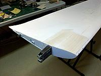 Name: 100_4468.JPG Views: 19 Size: 132.4 KB Description: The inner rib finally back in place together with the new key and the sanded balsa capping