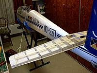 Name: 100_4476.JPG Views: 19 Size: 181.0 KB Description: The new half-completed lighter stab being positioned on the fuselage before drilling the mounting holes.
