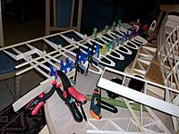 Name: 100_4578.JPG Views: 12 Size: 191.9 KB Description: Use lots of clamps to glue the nose to the main spar. Prefabricated aileron in between wing and fuselage