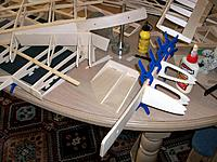 Name: 100_4579.JPG Views: 18 Size: 203.0 KB Description: Adding extra wood to better squeeze the wing keys in the main spar box. Space on the living room table became critical during some assembly phases
