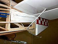 Name: 100_4685.JPG Views: 18 Size: 171.7 KB Description: The tail skid and stab struts are now as much functional as scale. To facilitate covering with Oratex I filled spaces above and below the stab with balsa. Scrap balsa was later used to fill the space above the stab when glued at the square angle