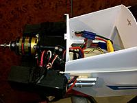 Name: 100_4731.JPG Views: 22 Size: 139.3 KB Description: Shown without cowling: batteries in the box, EC5 plugs routed through fueslage holes which are then closed by the fake exhaust holding plate, the exhausts prevent the batteries from sliding back during flight.