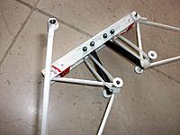 Name: 100_4745.JPG Views: 20 Size: 139.3 KB Description: To obtain better ground stability I modified the rubber system to completely individual leg suspension by adding four 3mm screws through the front beam. Two are for three half-widt rubbers and the other two for maximum limit nylon straps