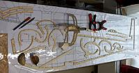Name: 100_4802.JPG Views: 3 Size: 155.0 KB Description: Fuselage formers and precut contour wood as laid-out on plan. If possible, modify at this stage to incorporate -3,5° of tailplane incidence.