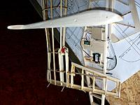 Name: 100_4818.JPG Views: 4 Size: 180.0 KB Description: Servo placement and fuselage connection of the horizontal stab. Leading edge of rudder already seriously sanded on one side to allow adequate rudder deflections versus the pear shaped fuselage bottom