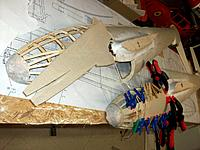 Name: 100_4841.JPG Views: 2 Size: 198.5 KB Description: preparing and gluing the forward side-planking. The nose halves can be seen with their initial polyester filler and the wing fillets with their lightweight filler to obtain the smooth desired flowing contours