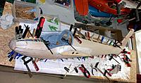 Name: 100_4851.JPG Views: 3 Size: 184.0 KB Description: Final mating fuselage halves required my complete inventory of all things that could hold parts together whilst the glue settled.