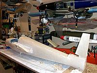 Name: 100_4862.JPG Views: 3 Size: 199.5 KB Description: Except along the lower aft skid area, the planking is complete and the fuselage still straight as an arrow. My unrecommended method was successful at the end.