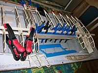 Name: 100_4897.JPG Views: 3 Size: 497.2 KB Description: Upper wing spar glued to ribs, spoiler box glued to both spars necessitating removal of the spoilers, alignment at aft of ribs ensured by temporary construction. Inner wing rib 1 and 2 glued together.
