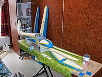 Name: 100_4962.JPG Views: 4 Size: 505.2 KB Description: Elaborate masking of all the curves before painting the blue over the lightly sanded beige underground. Ailerons not yet glued to the wings. All servo access panels also painted twice