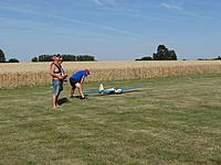 Name: pottes maiden 4 2019.jpg Views: 4 Size: 134.3 KB Description: Tow-pilot Danny clears the sky for the position of the other gliders, I clear the runway, John holds the wing off the ground, seconds later I was rolling for the maiden flight of my painstakingly built latest model