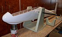 Name: 100_5104c.JPG Views: 30 Size: 330.9 KB Description: My narrow transport craddle along a universal one I made so an entire fuselage can be painted (with a roller) in one go. Take the pot away under the nose and put the weight in the nose so  the tail lifts high in the air to paint the underside (first).