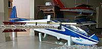 Name: 100_5150c.jpg Views: 37 Size: 415.3 KB Description: Measuring incidences along the wings and against the horizontal tail. The four spoilers could also be synchronized at this stage. Note the pronounced nose-low attitude with zero wing incidence