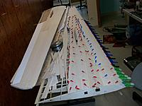 Name: 100_5161.JPG Views: 26 Size: 492.5 KB Description: After planking I added balsa to the tips so they could be sanded flush with the rest of the wing and aileron profiles. Note I also extended the flaking of the extrados over the aileron leading edges to keep the gap minimal and augment the venturi effect