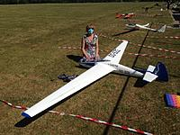 Name: preflight maiden.jpg Views: 58 Size: 186.6 KB Description: Preparing for the maiden during Covid-19 regulated times, models 5m apart in the parking lot and all pilots wearing masks.
