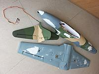 Name: 100_5206c.jpg Views: 57 Size: 568.2 KB Description: Underside of wings got the filler treatment as well as around the plastic intakes. A 4-strand wiring connects the tail to the fuselage. the various green shades were first tested on the tail section