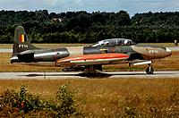 Name: t33 FT-14-filtered.jpg Views: 214 Size: 349.2 KB Description: That is the real one as they were used for training in 1972 at Brustem, note the travel pod under the fuselage and stowed instrument-hood curtain behind the back-seater. Black nomenclature and white nose in that year