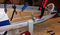 Name: 100_5314c.jpg Views: 21 Size: 575.1 KB Description: Gluing the stringers and canopy-rail parts in their correct position and shapes again