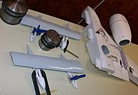 Name: 100_5442c.jpg Views: 310 Size: 500.8 KB Description: Gluing the flap hinges to the canoes before the complete assembly is mated to the wings