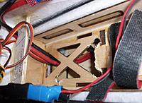 Name: 100_5497c.jpg Views: 92 Size: 696.9 KB Description: The nylon bolts were hardly accessible, one of them barely visible in to left corner of the wood. I drilled out some more wood to access the forward nylon bolts with a long screwdriver