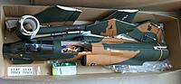 Name: 100_5576cr.jpg Views: 15 Size: 475.7 KB Description: That is how it came out of the box. You can clearly see the relatively important thickness of the minimal semi-symetrical wings. The ugly servo's in the vertical tail deserve a better camouflage.