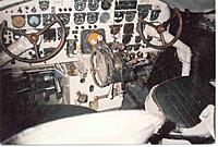 Name: cockpit.jpg Views: 84 Size: 39.9 KB Description: Cockpit of N49AG with white tail wheel lock lever protruding under the throttle quadrant