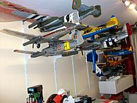 Name: 100_2143.jpg Views: 83 Size: 183.7 KB Description: Present stockroom, most foamy models, but modified or painted to represent real aircraft I have special connections with (except the Mustang I use as a trainer and experiment aircraft for settings, gyro's etc)