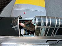 Name: T6Harvard0_10.jpg Views: 403 Size: 149.7 KB Description: Not much space left after cockpit assembly is fitted. carbon strips visible along canopy rail. Pilot hair and flight jacket painted to represent present aircraft owner.