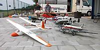 Name: mobile hangar_13.jpg Views: 238 Size: 127.5 KB Description: Part of my historic RC fleet during summer 2013 in front of my narrow door camper/mobile hangar.