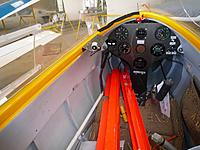 Name: P1020172.jpg Views: 59 Size: 159.0 KB Description: interior of the original, note broken perspex on closed canopy with sliding side window, microphone, stick, hook disconnect and spoiler parts clearly visible
