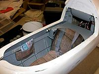Name: mod cockp_23.jpg Views: 70 Size: 135.5 KB Description: cockpit painted, seat installed, map pouch attached with metal strip as per original, microphone glued to cover plate,  headrest panels ready for painting, fake rudder cables along the fuselage