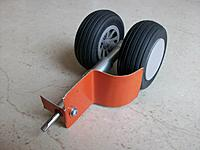 Name: geardoors.jpg Views: 123 Size: 101.2 KB Description: trial fit of roughly shaped geardoor made from scrap tin, this to verify if the single bolt was sufficient to cater for airstream forces