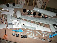 Name: wing assembly.jpg Views: 107 Size: 200.3 KB Description: After vinyling the top of the wings and a few bottom surfaces I glued the nacelles with the long CF wing reinforcement rods and filled the depressions with filler before vinyling the bottom. Rest of the parts around are awaiting final installation